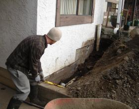 Excavation and repair of a newer drain tile system in Victoria BC