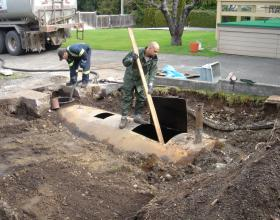 Pumping and cleaning commercial buried oil tank in Victoria BC