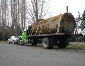 Trucking away commercial oil tank in Victoria BC