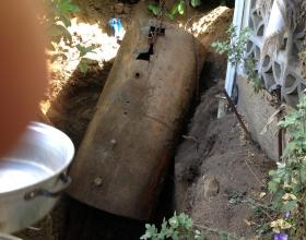 A leaking buried oil tank being removed in Victoria BC