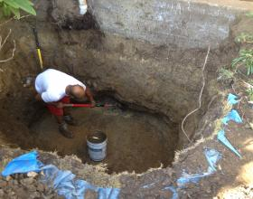 Hand excavating oil contaminated soil in Victoria BC