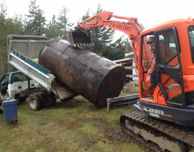 Large buried oil tank removed from residence in Victoria BC