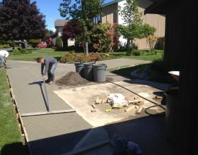 Finishing concrete driveway extension in Victoria BC