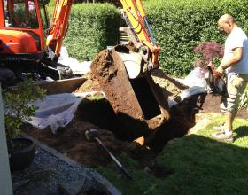 digging out buried oil tank from back yard in Nanaimo BC