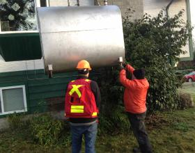 Inspecting oil tank for cause of leak in Duncan BC