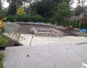 Landscaping with plants, bushes and retaining wall in Victoria BC