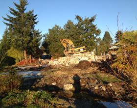 Excavator on demolished house in Victoria BC