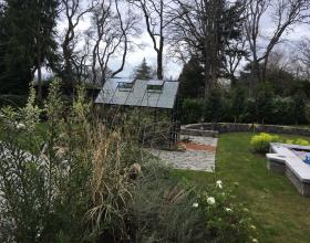 Landscape of backyard with lawn and greenhouse in Victoria