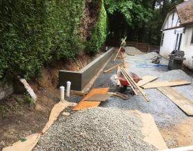 Retaining wall being stripped of forms in Victoria BC