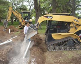 Installing drain rock in septic field in Victoria BC