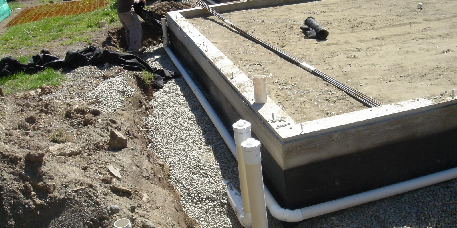 Concrete house foundation and drainage